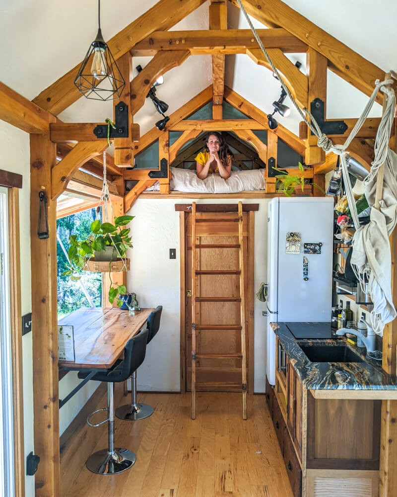 Timber Frame Tiny House on Wheels, Clara Relaxing in the secondary loft