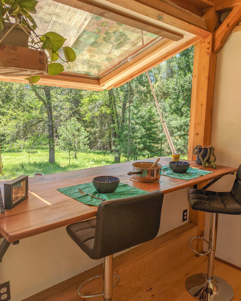 Timber Frame Tiny House on Wheels, Large Gas-Strut Assisted Window Opens up this beautiful tiny house and provides a perfect eating area