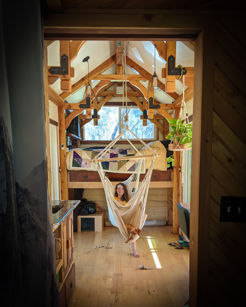 Timber Frame Tiny House on Wheels, Clara Relaxing in her hammock with whiskey